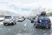 Winter Highway With Many Different Cars Stucked In Traffic Jam Due Ti Bad Weather Conditions. Vehicl poster