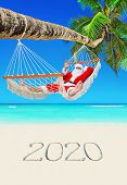 Santa Claus Relax In Mesh Hammock Under Coconut Palm Tree At Tropical Paradise Ocean Beach With Hand poster