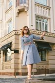 Woman Walking In Dress In Old City. Fashion Style Photo Of A Young Girl. Happy Stylish Woman At Old  poster