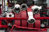 foto of firehose  - row of fire hoses on a fire truck - JPG