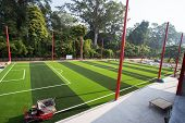 White Stripe On The Green Soccer Field From Top View. Beautiful Pattern Of Fresh Green Grass For Foo poster