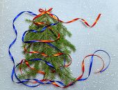 Festive Christmas Background. The Christmas Tree Is Decorated With Colored Ribbons. Red And Blue Rib poster