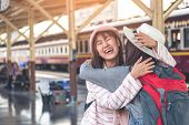 Two Beautiful Asian Women Happy Embrace Upon Meeting At The Train Station. Two Women Having An Appoi poster