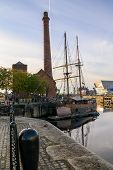 The Pump House And A Tall Ship In Canning Dock, Liverpool. Part Of The Redevelopment Of The Albert D poster