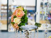 Bouquet Of Roses On The Table. Wedding Bouquet And Roses Bouquet On The Table. Selective Focus poster