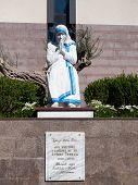 Statue Of A Seated, Praying Mother Teresa At St. Pauls Roman Catholic Cathedral In Tirana Albania poster