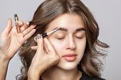 Portrait Of A Beautiful Happy Woman  Thick Eyebrows And With Clean Skin In A Beauty Salon. Makeup Ar poster