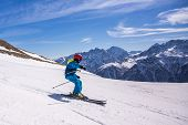 Little Boy In Blue And Yellow Ski Costume Skiing In Downhill Slope. Winter Sport Recreational Activi poster