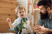 Children Emotions. Cute Child Shows Dinosaur To Father. Acting Like Animal, Playing Games. Concept O poster