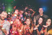 Happy Friends Doing Party Throwing Confetti In Nightclub - Group Young People Having Fun Celebrating poster