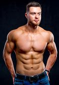 Bodybuilder Posing. Beautiful Sporty Guy Male Power. Fitness Muscled Man poster