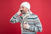 Stay Warm During Winter With Fashion Accessories. Happy Man In Casual Fashion Wear Red Background. M poster
