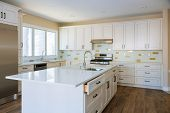 Installing Cabinets And Counter Top In A White Kitchen Partially Installed Furniture. poster