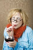 pic of tawdry  - Crazy woman with crossed eyes drinking wine through a straw - JPG