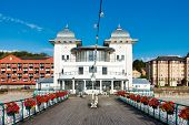 Penarth Pier Pavilion And Penarth Pier In Summer 2019 With Beautiful Flowers Hanging On The Victoria poster