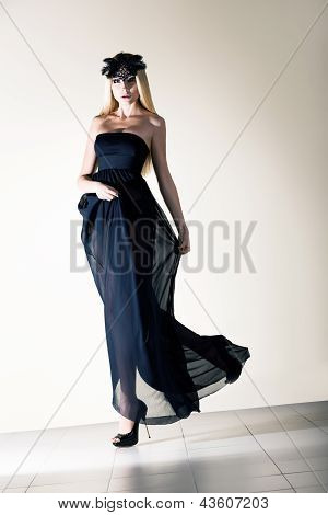 Sensuality. Stylish Dynamic Woman In Black Transparent  Frock. Elegance