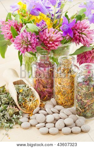 Different Healing Herbs In Glass Bottles, Flowers Bouqet, Tablets, Herbal Medicine