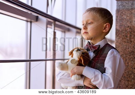 Little boy dreaming about live puppy