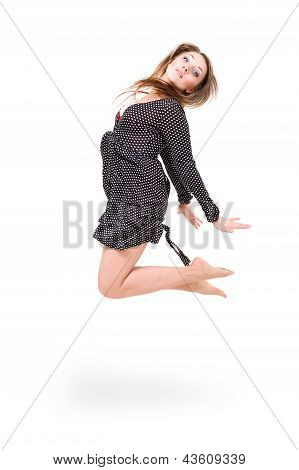 beautiful girl wearing a dress jumping up