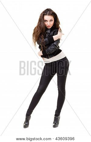 young woman in a black leather jacket and jeans