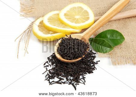 Wooden Spoon With Leaves Tea And Fresh Green Lemon Leaf Isolated On White Background.