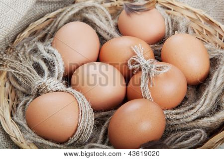 Brown Eggs In A Basket On The Canvas.