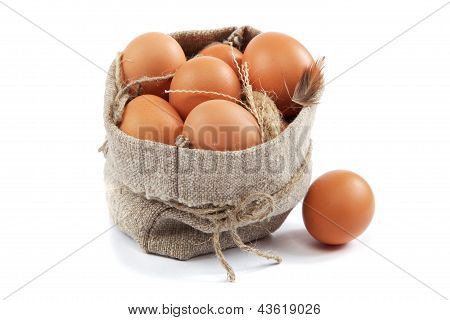 Brown Eggs In Canvas Sack Isolated On A White Background