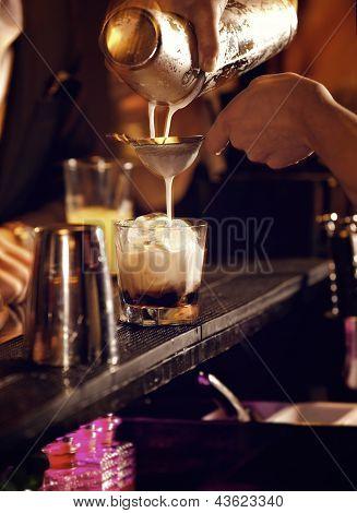 Bartender Making A Cold Cocktail Drink