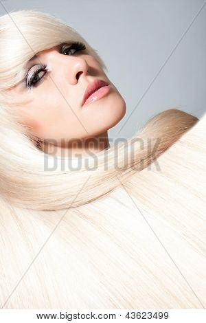 Blond Girl. Healthy Long Blond Hair.