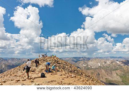 Hikers On The Summit Of Mount Elbert