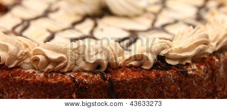 beautiful part of the cake with a delicious cream closeup