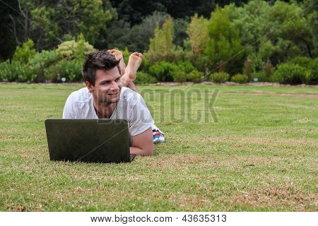 Man Working On Notebook Outdoors