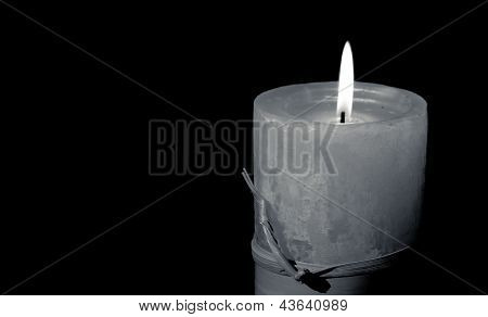 Artisan candle on black background