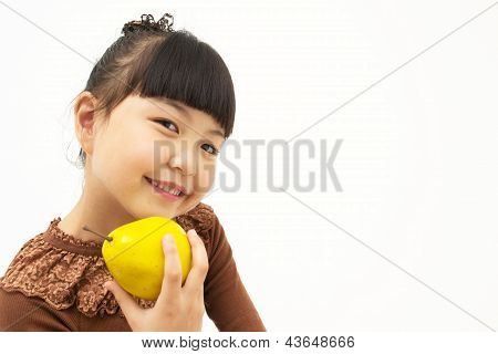 Cute asian kid with a quince