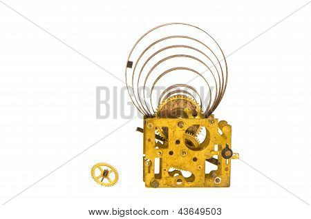 Ancient Clock Brass Gears And Steel Mainspring Isolated