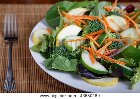 Fresh Vegetable Salad On Bamboo Mat With Fork