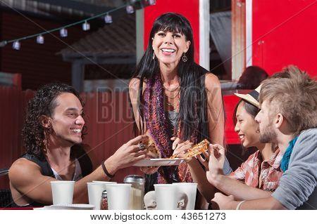 Joyful Group Sharing Pizza