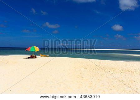 Blue skies and white sand beach