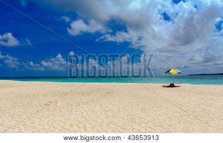 Beach umbrilla & white beach
