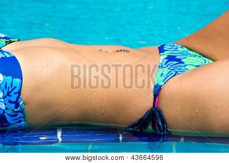 Woman Belly On The Swimming Pool