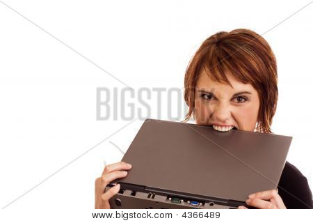 Frustrated Caucasian Businesswoman Biting Laptop