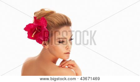 Portrait Of Beautiful Spa Woman Face With Red Flower In Hair, Looking Away.