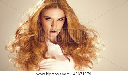 Portrait Of Beautiful Woman With Red Hair, Looking At Camera