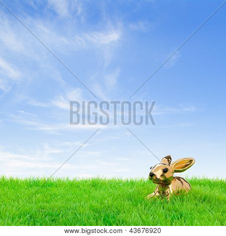Golden Easter Bunny In A Bright Field