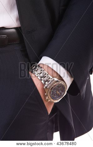 Businessman's hand in the pocket with wristwatch.
