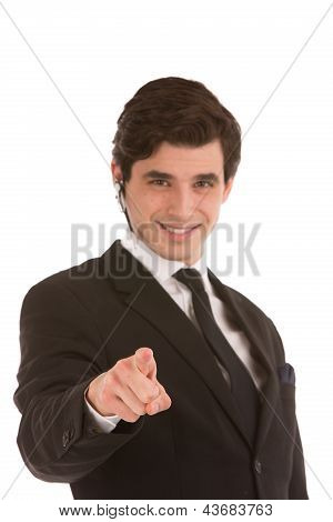 Businessman Smiling And Pointing Forwards