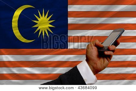 Cell Phone In Front  National Flag Of Malaysia