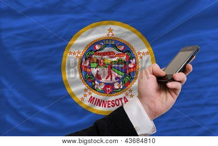 Cell Phone In Front  Flag Of American State Of Minnesota