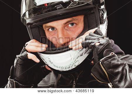 closeup man face wearing helmet