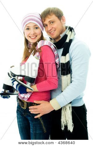 Happy Young Couple Going Ice-skating
